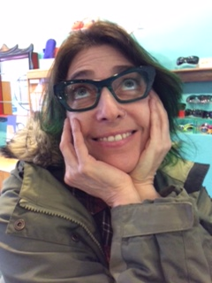 Karen in her colorful green Theo eyeglasses frames